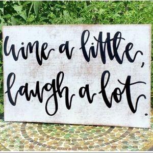 "Accessories - Handwritten ""Wine a little, laugh a lot"" wood sign"